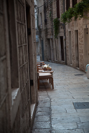 Alley cafe Tables and Chairs in Split street cafe © 2010 Nick Katin