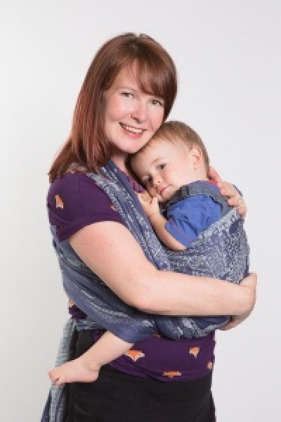 Mum and toddler cuddling using a woven wrap