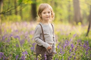 Spring Wood Whalley - Boy wearing trousers with braces standing among bluebells