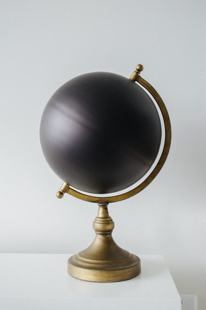 Black globe shows, that market all around the world is mystery until you start using market research