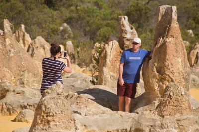guy getting his photo taking with strange rock formations