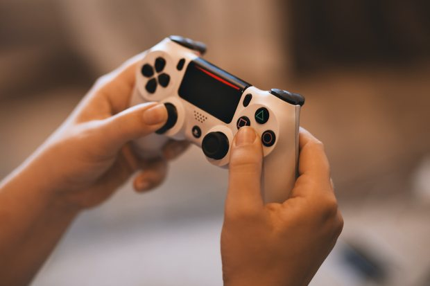person-holding-sony-ps4-controller-1174597