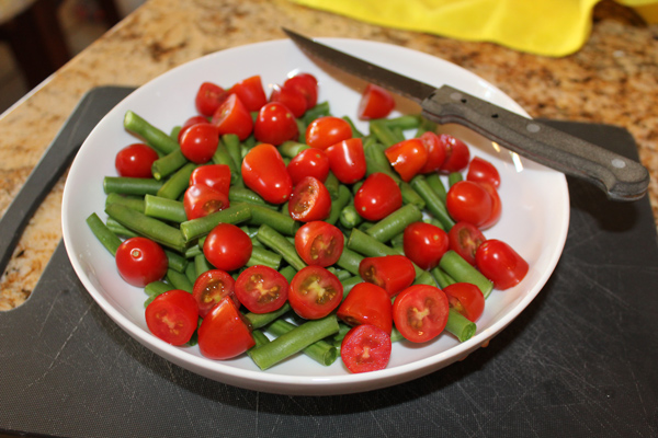 tomatoes and green beans in a bowl
