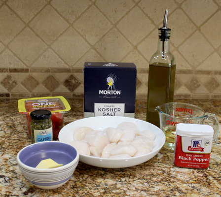 Ingredients for pan seared scallops with tomatoes and capers