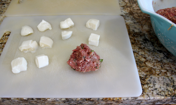 pinch the meat closed to cover the mozzarella cheese