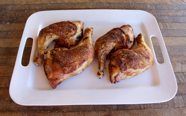 juicy chicken leg quarters on a plate