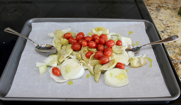 vegetables spread out on sheet pan