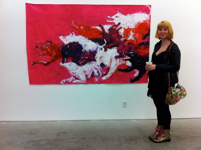 Jasmine Schuett in front of her painting