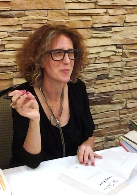 Gayle Forman, author of LEAVE ME,, signs copies of her adult and young adult novels March 22, following her author talk at the Fort Collins Hilton. Photos by Shelley Widhalm/Shell's Ink Services.
