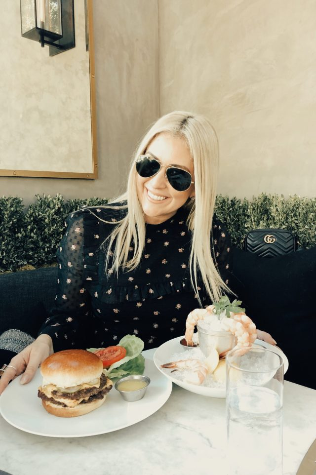 Fashion and food blogger Kat Ensign at RH Yountville with a burger