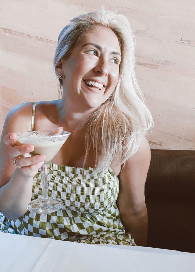 Fashion blogger KatWalkSF wearing the Natasha Smocked Midi Dress drinking an espresso martini at Firenze by Night