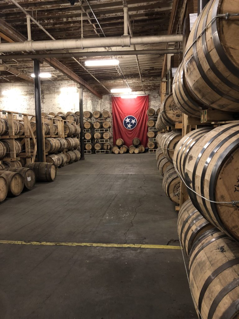 Hundreds of barrels of whiskey stored on their sides.