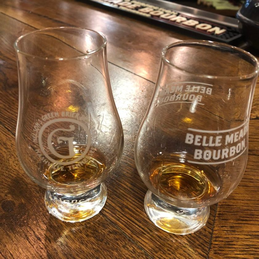 Two empty whiskey tasting glasses with their logo on them.
