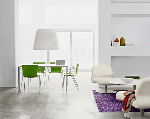 The green and purple and the knick-knacks in wood tones help but still more could be done.