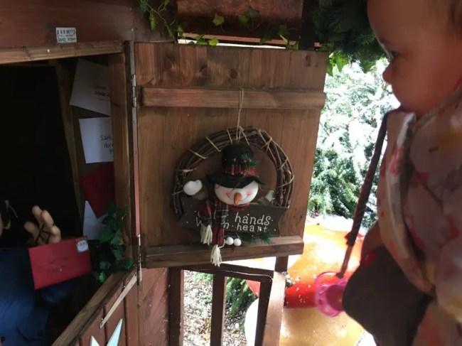 Santa's Woodland Workshop - Daisy investigating the little displays