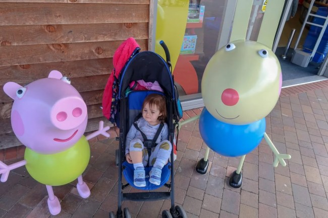A family trip to Peppa Pig World - Daisy outside the gift shop