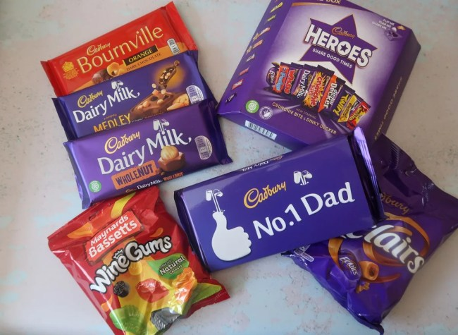 A selection of Cadbury chocolate bars, wine gums and No 1 Dad sleeve.