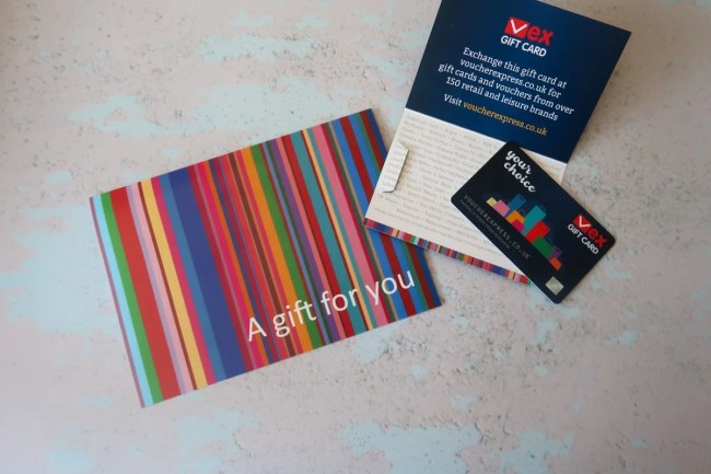 Voucher Express Gift Certificate and decorative rainbow coloured envelope