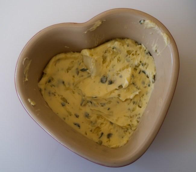 Garlic butter in a heart shaped ramekin