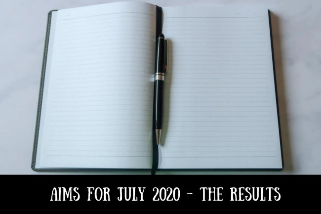 A notebook and pen with text that says Aims for July 2020 - the results