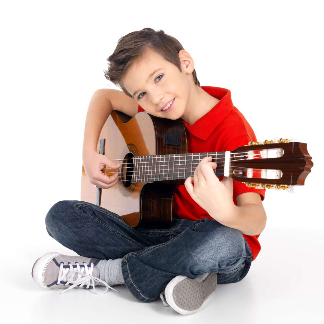 Boy taking guitar lessons at The Conservatory of Music at North Katy