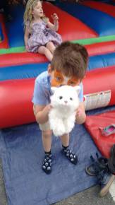 Ollie on the bouncy castle in face paint (OK to use)