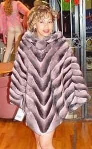 Marc Kaufman Furs presents a pink chinchilla fur poncho from Marc Kaufman Furs New York,Fur coats in Argentina, fur coats in Chile, fur coats in Venezuela, fur coats in Australia, fur coats in Belgium,fur coats in Netherlands, fur coats in Norway,fur coats in Sweden,fur coats in Dubais,fur coats in Egypt,fur coats in Egypt,fur coats in Kuwait, fur coats in South Africa,fur coats in Tunisia,fur coats in the Falklands