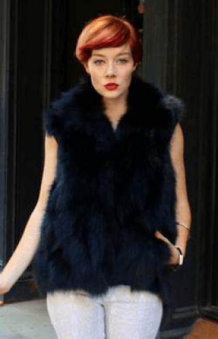 woman wearing black fox fur vest
