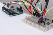 Arduino microcontroller with laser sensor gate