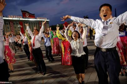 People participate in a mass dance in the capital's main ceremonial square, a day after the ruling Workers' Party of Korea party wrapped up its first congress in 36 years, in Pyongyang. REUTERS/Damir Sagolj