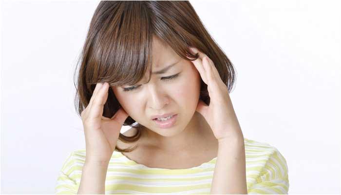 つらい生理痛の女性のイメージ画像