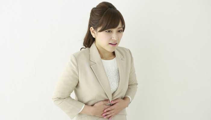生理不順と胃痛下痢で悩む女性のイメージ画像