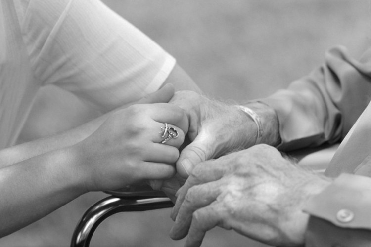 And old and young person holding hands