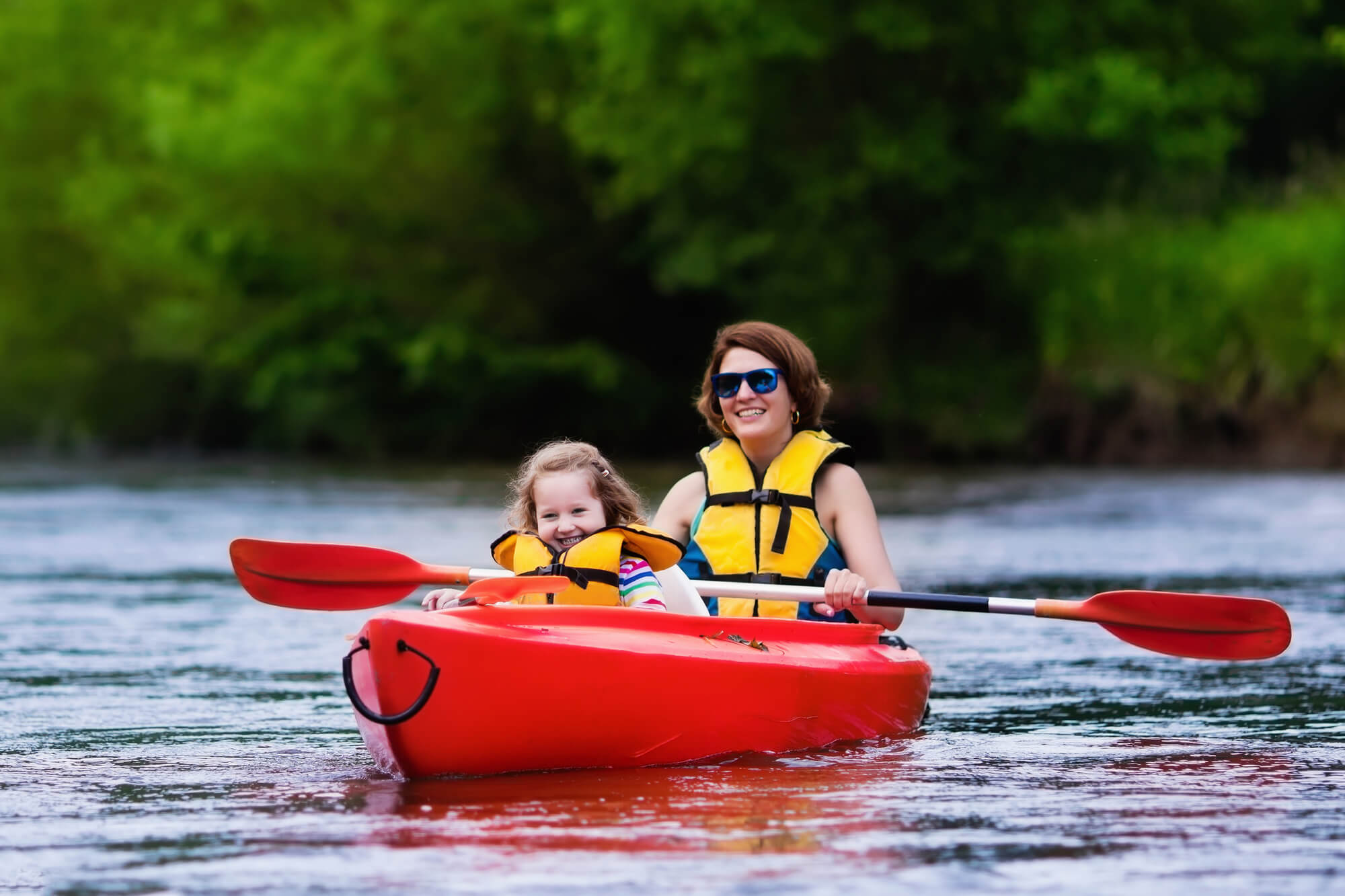 Beginners on kayak - woman and child