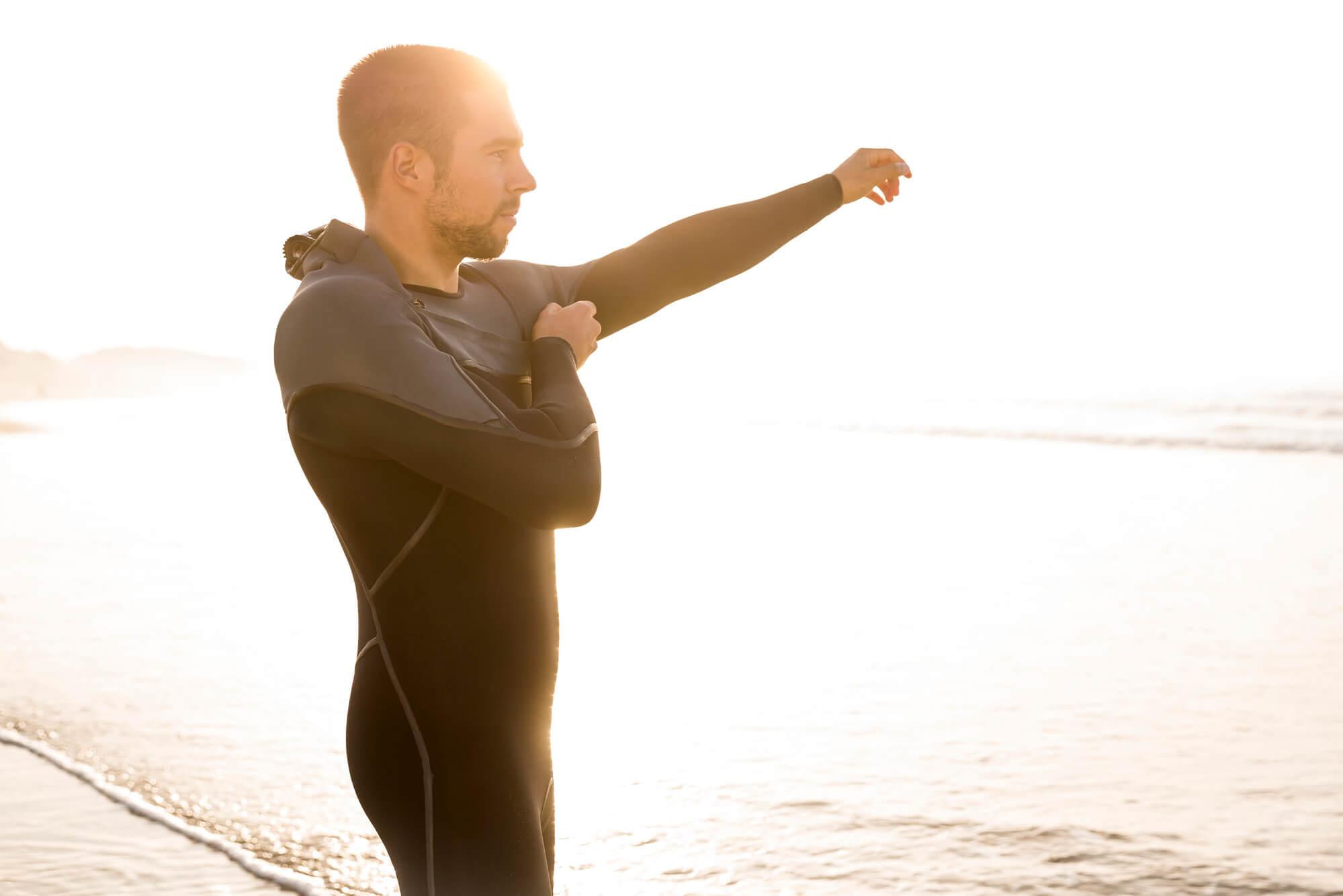 Man In Wetsuit On Beach
