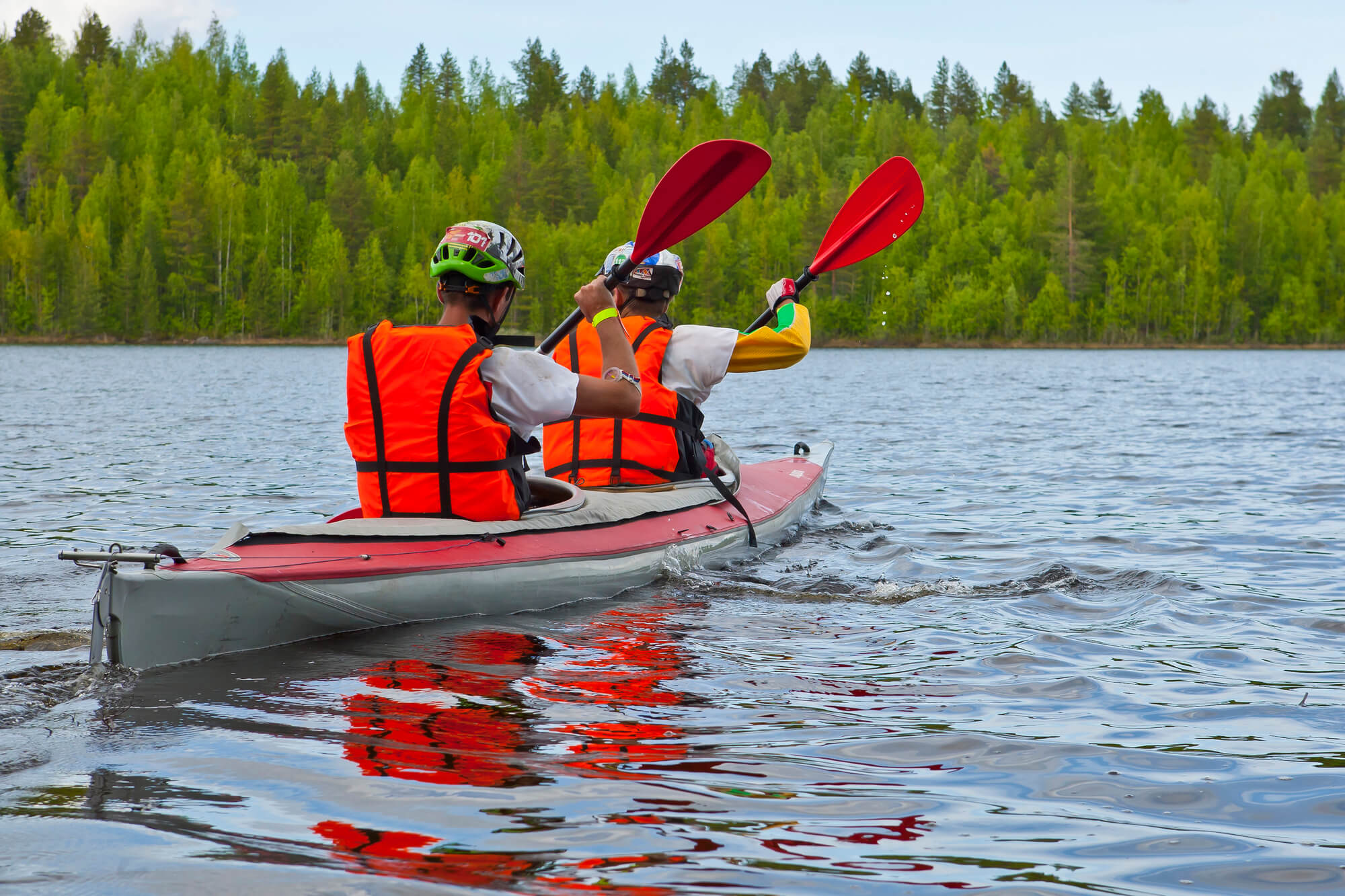 Tandem Kayaking Canoeing With Life Jackets