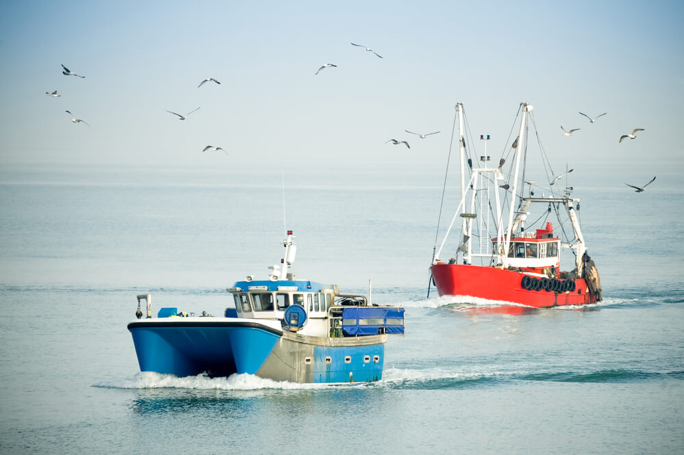 fishing trawlers passing each other