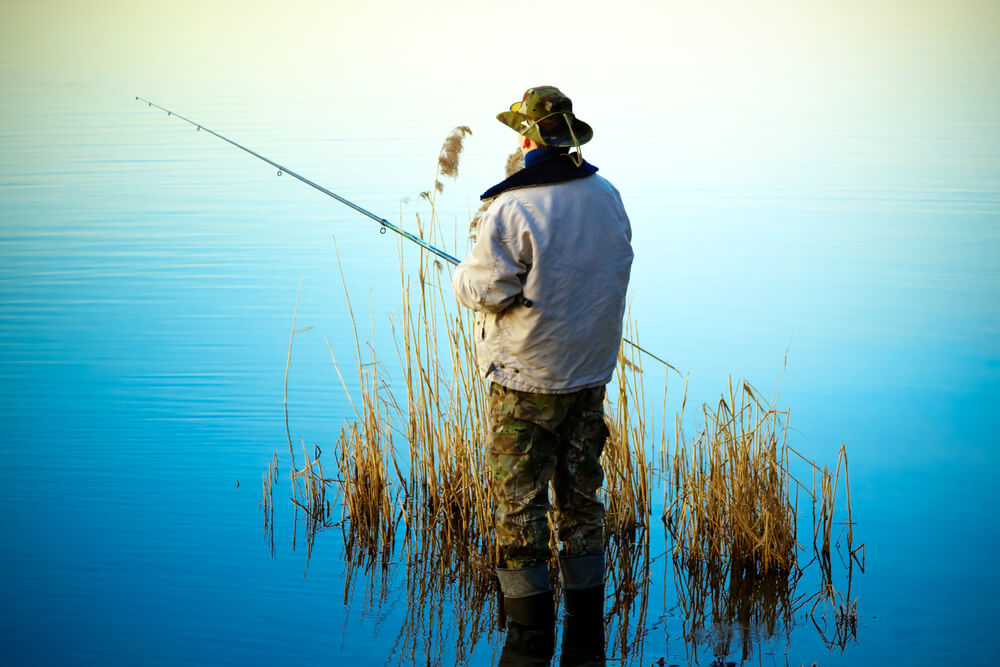 Fishing on calm lake with a rod and reel