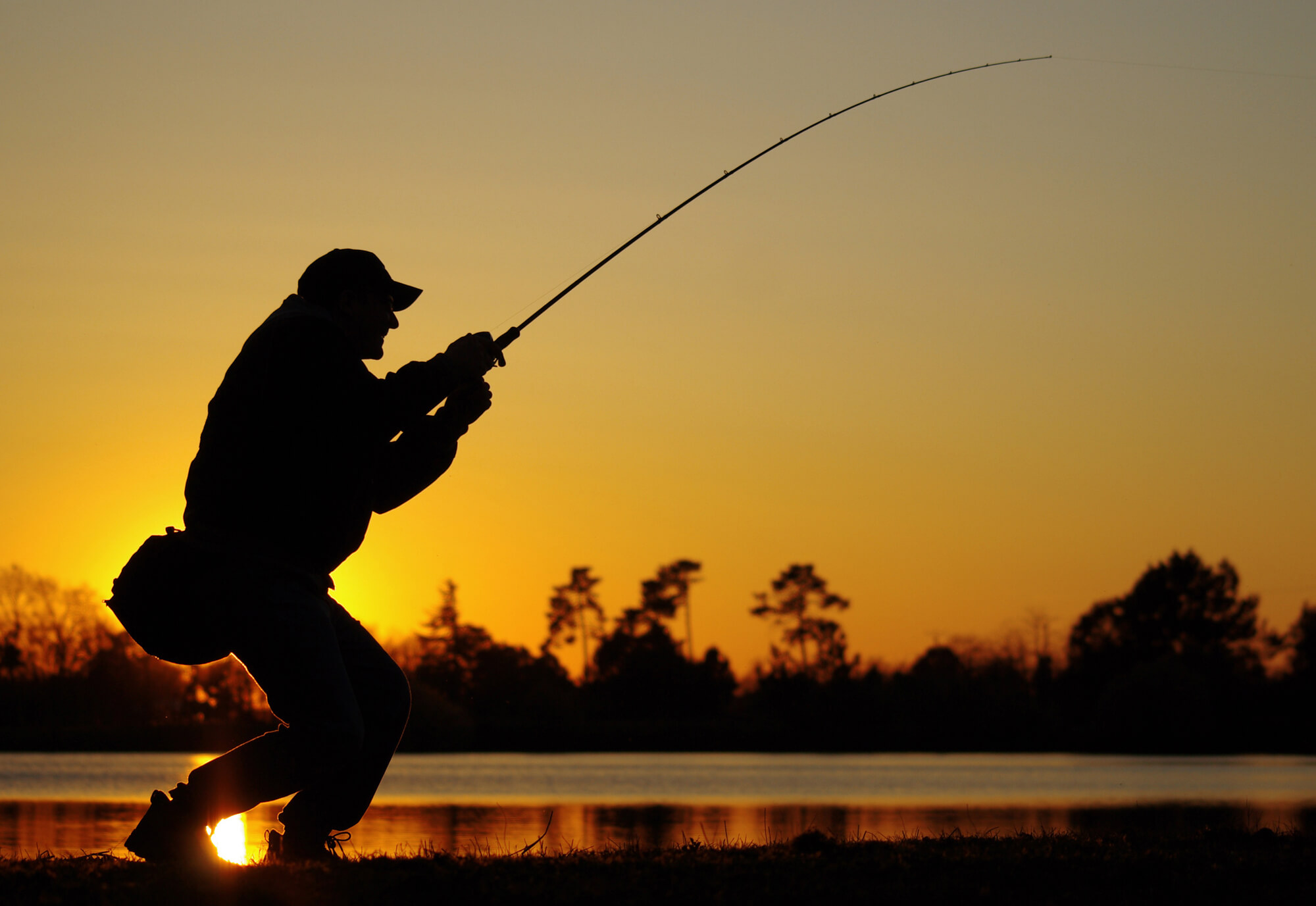 Fishing on river for bass during sunset