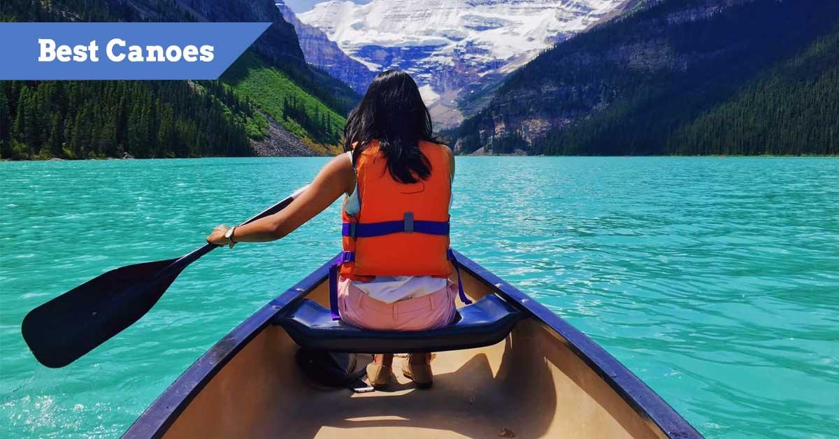 Woman Paddling a Canoe across a beautiful bright lake