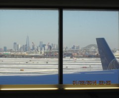 Snowy Newark, New Jersey airport with New York City in background.
