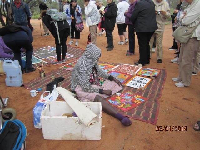 Aboriginal artist selling her paintings.