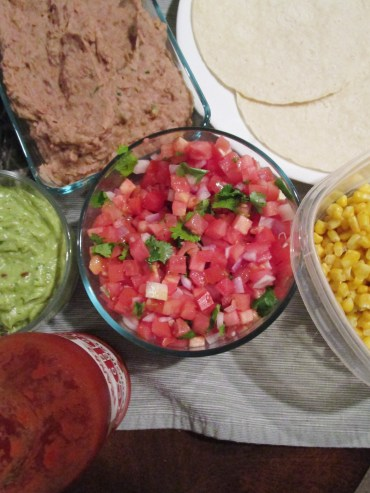 "When I'm feeling fancy I add a sweet and spicy guacamole, fresh salsa, corn and re""fried"" beans."