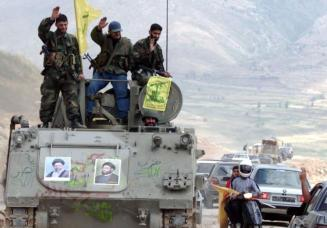 Pro-Iranian Hezbollah guerrillas, riding on an APC M113. REUTERS