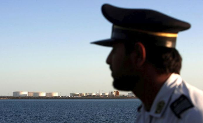 FILE PHOTO: A security personnel looks on at oil docks at the port of Kalantari in the city of Chabahar, 300km (186 miles) east of the Strait of Hormuz, Iran January 17, 2012. REUTERS/Raheb Homavandi