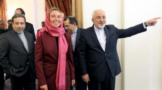 FILE PHOTO: Iran's Foreign Minister Mohammad Javad Zarif (R), European Union foreign policy chief Federica Mogherini (C) and Iran's chief nuclear negotiator Abbas Araghchi (L) arrive for a meeting in Tehran July 28, 2015. REUTERS
