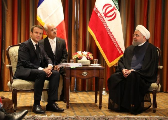 FILE PHOTO: France's President Emmanuel Macron (L) meets with his Iranian counterpart Hassan Rouhani (R) in New York on September 18, 2017, as world leaders gathered in the United States for the UN General Assembly (AFP Photo/LUDOVIC MARIN)