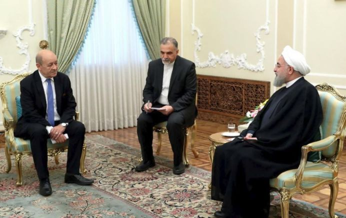 FILE PHOTO: Iranian President Hassan Rouhani meets with French Foreign Affairs Minister Jean-Yves Le Drian, in Tehran, Iran, March 5, 2018. REUTERS