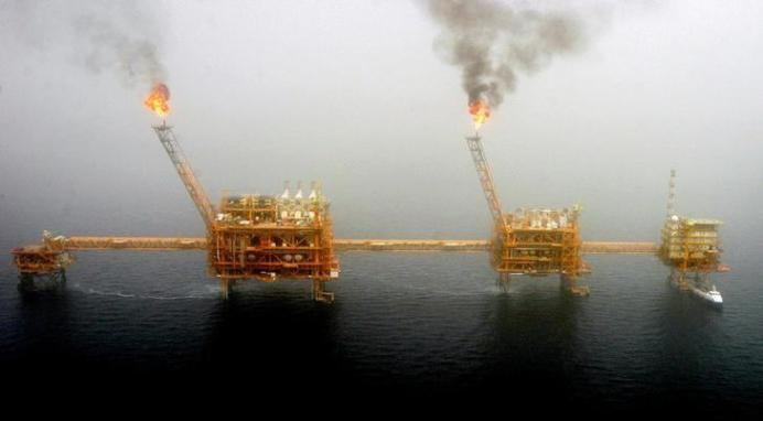 FILE PHOTO: Gas flares from an oil production platform at the Soroush oil fields in the Persian Gulf. REUTERS