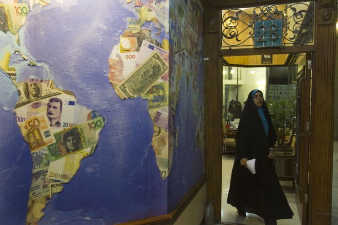 FILE PHOTO: A woman leaves an exchange office at a shopping centre in northern Tehran, Iran. Reuters./